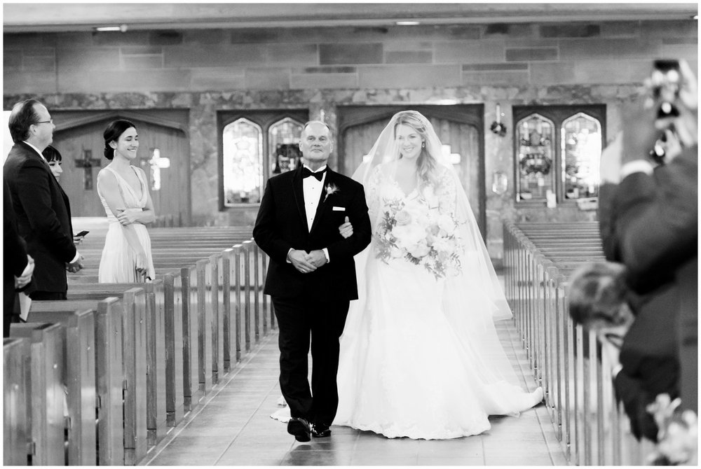 father walks daughter down aisle on wedding day