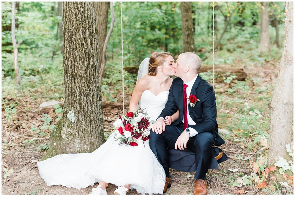 wedding portraits in woods on swing