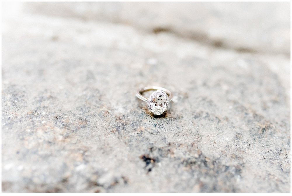 engagement ring on cobblestone street