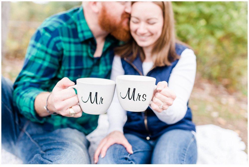 couple enjoying hot chocolate in mugs