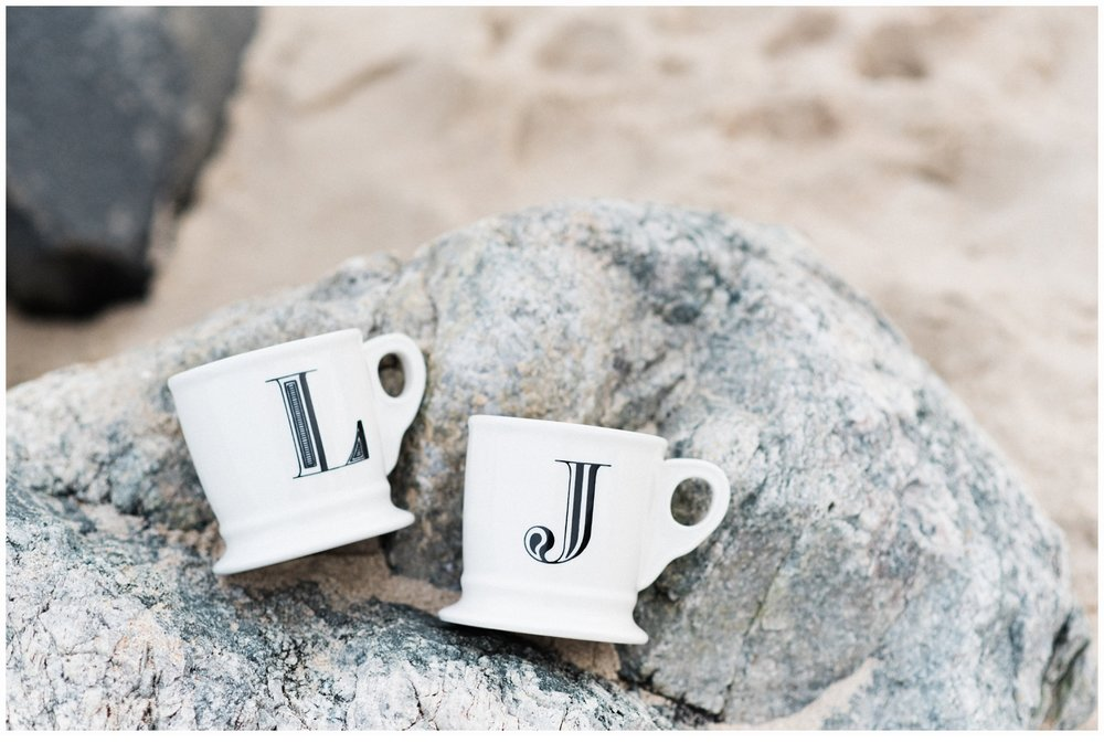 coffee mugs on rocks on beach