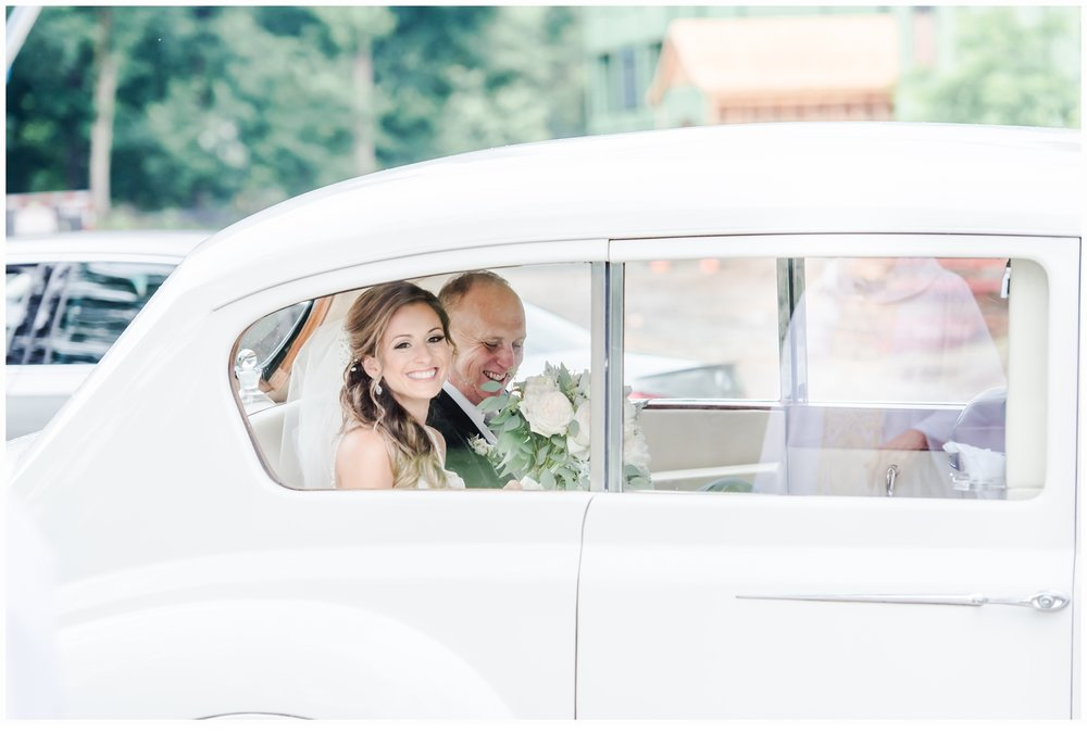 father and daughter on wedding day in limo