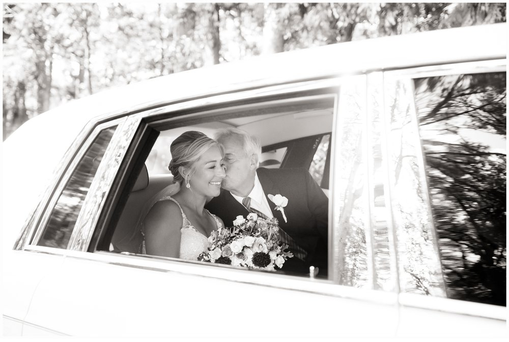 father and daughter in limo on wedding day
