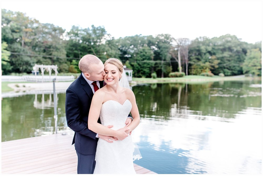 bride and groom portraits on dock on lake