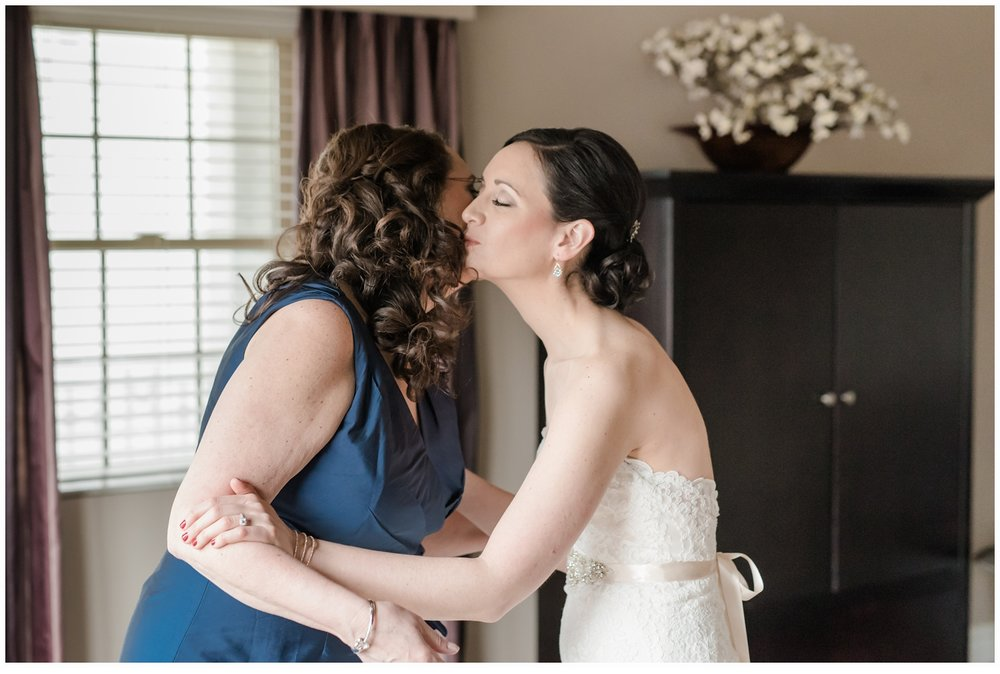 wedding day mother and daughter kiss