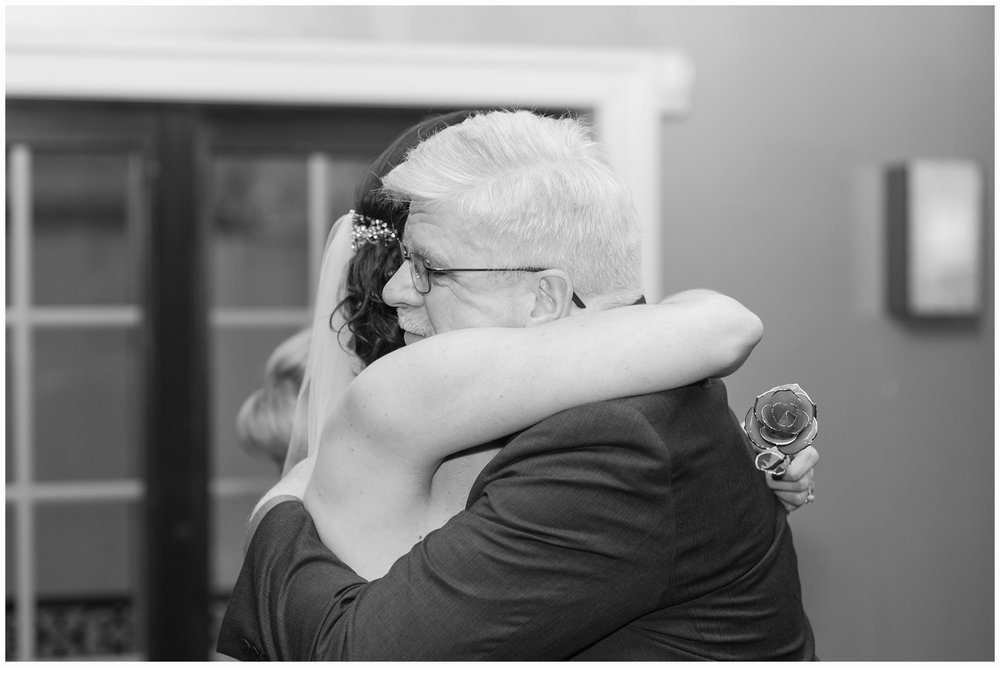 bride hugging her father in law