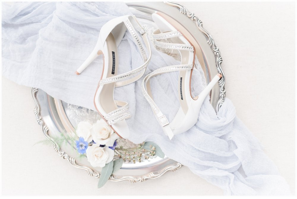 wedding shoes on pretty silver tray