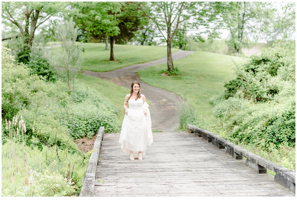bride on bridge on wedding day