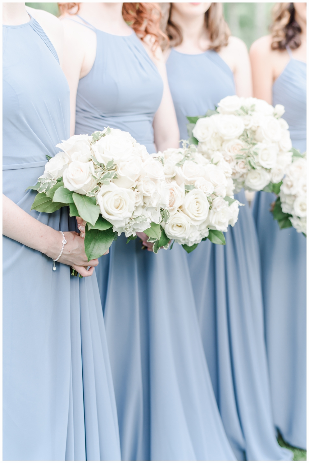 bridesmaids carrying bouquets