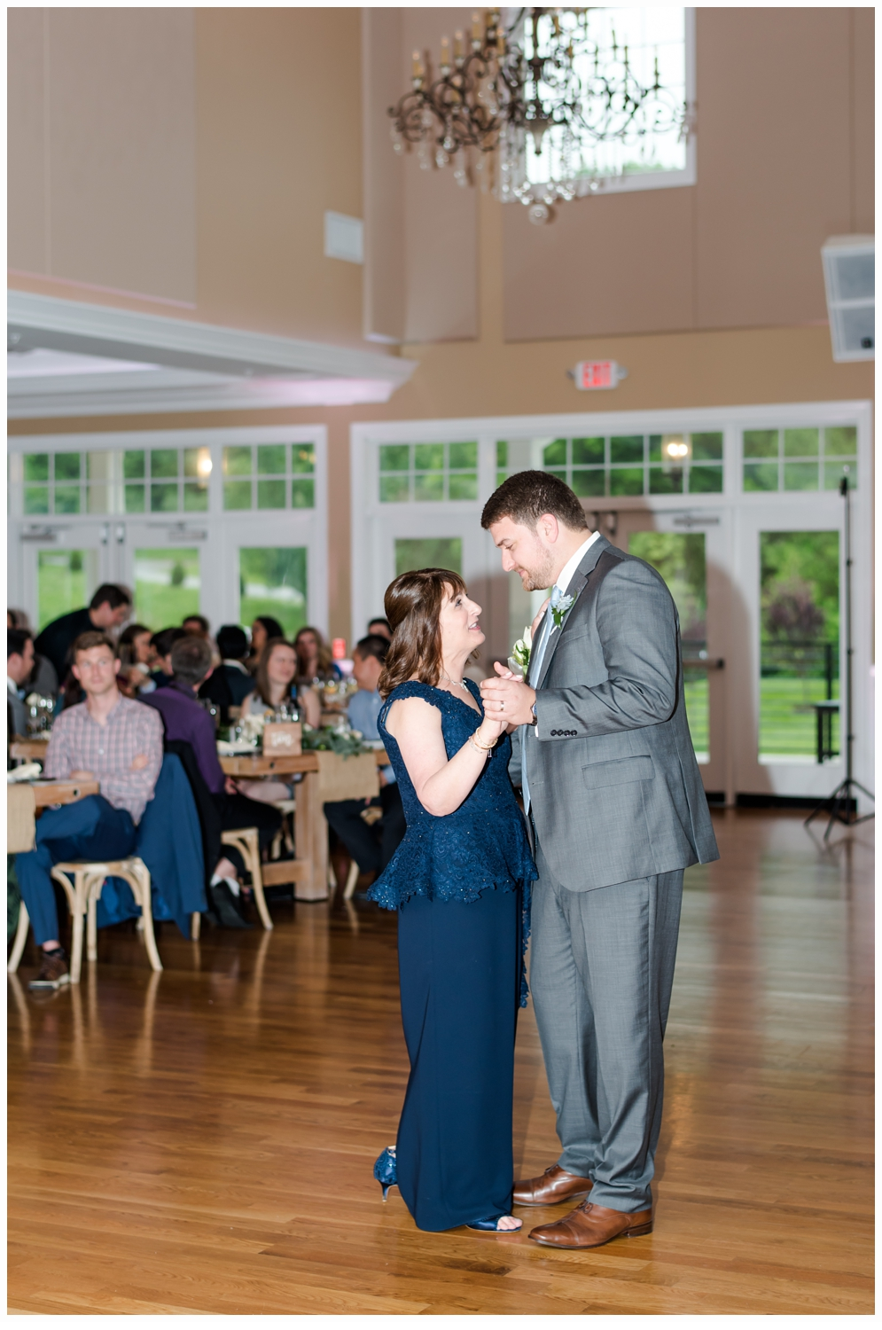 mother and son dancing at wedding