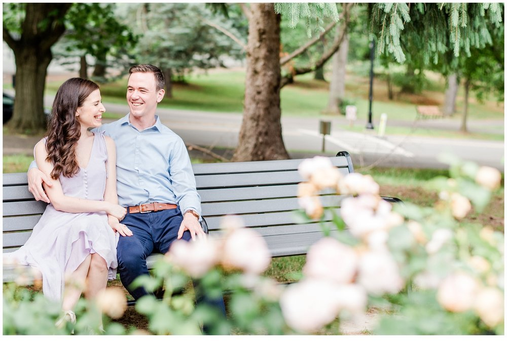 couple laughing on park bench