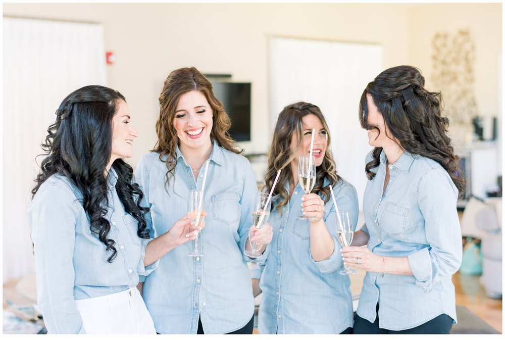 bridesmaids drinking champagne
