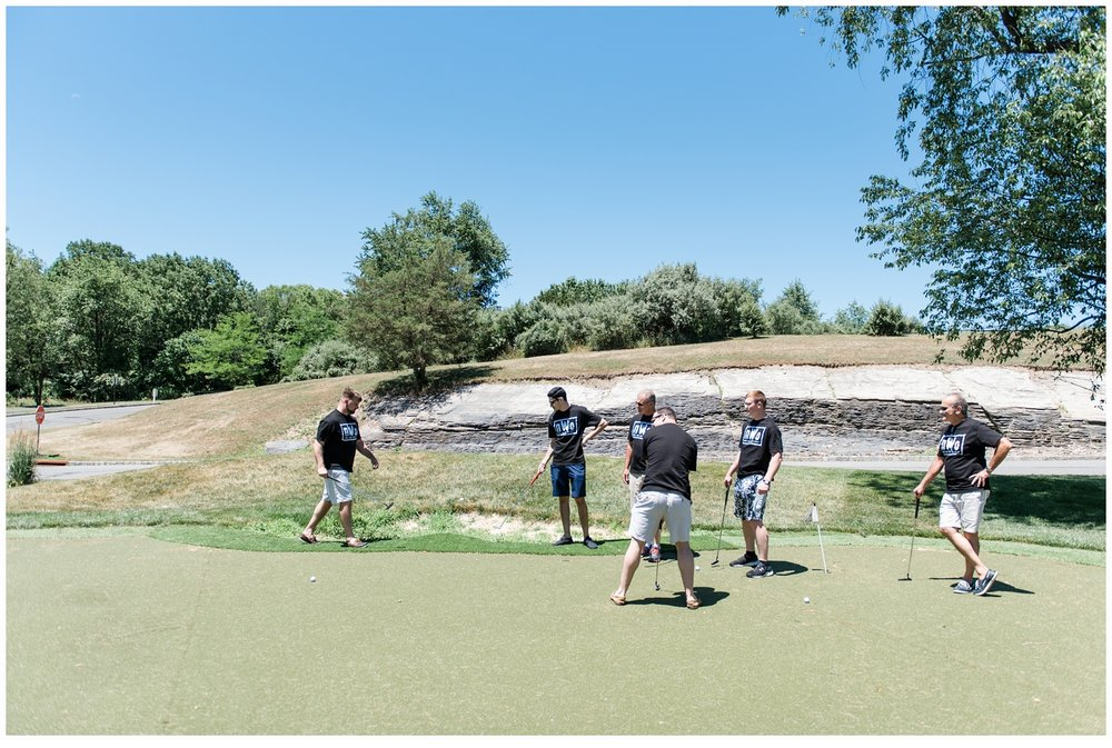 groom and groomsmen on putting green