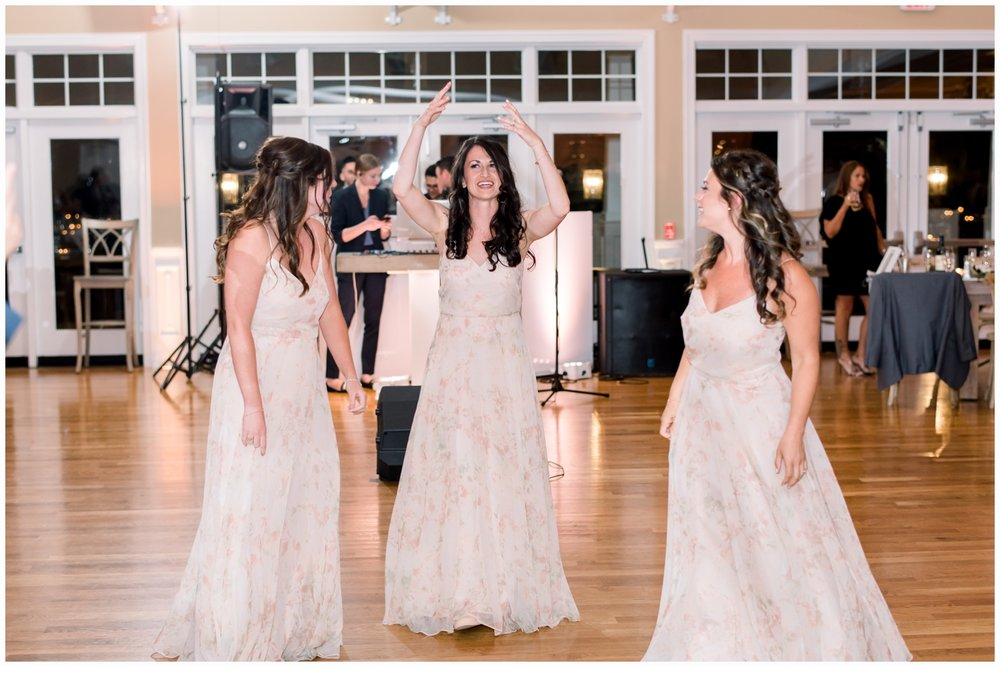 bridesmaids dancing at reception