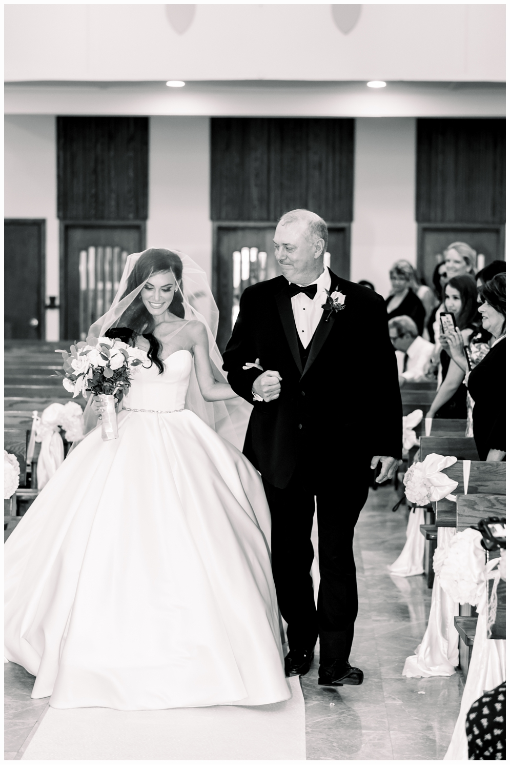 dad escorting bride down the aisle in church