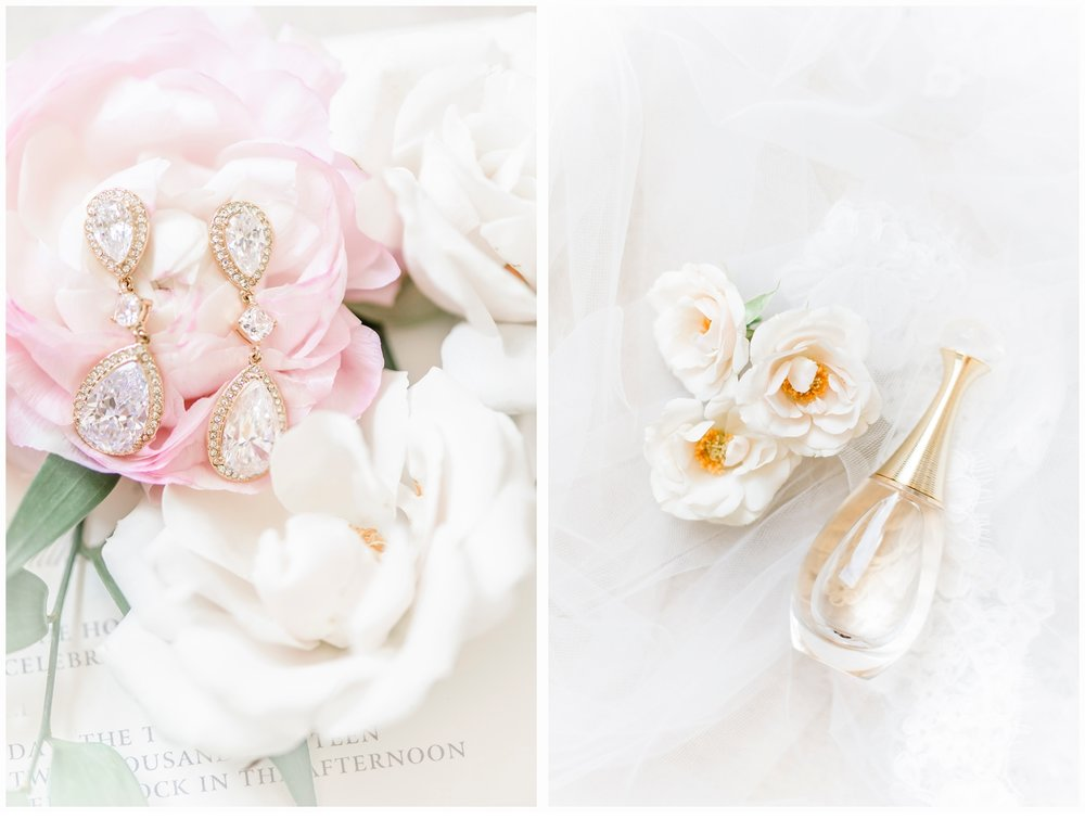 brides earrings and perfume in flowers