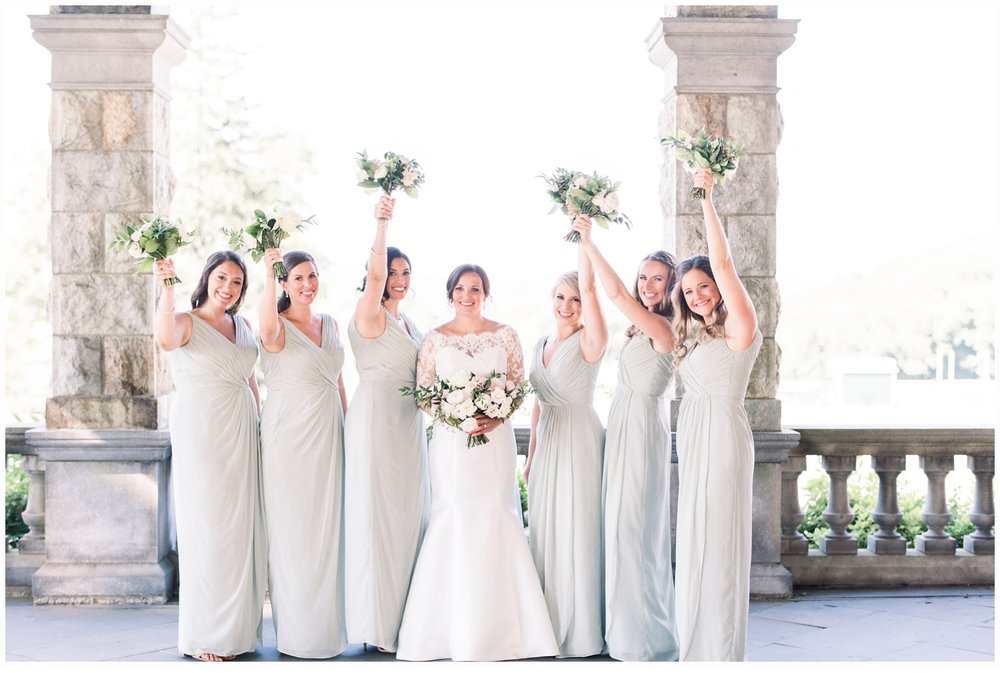 bride and bridesmaids lifting bouquets shouting