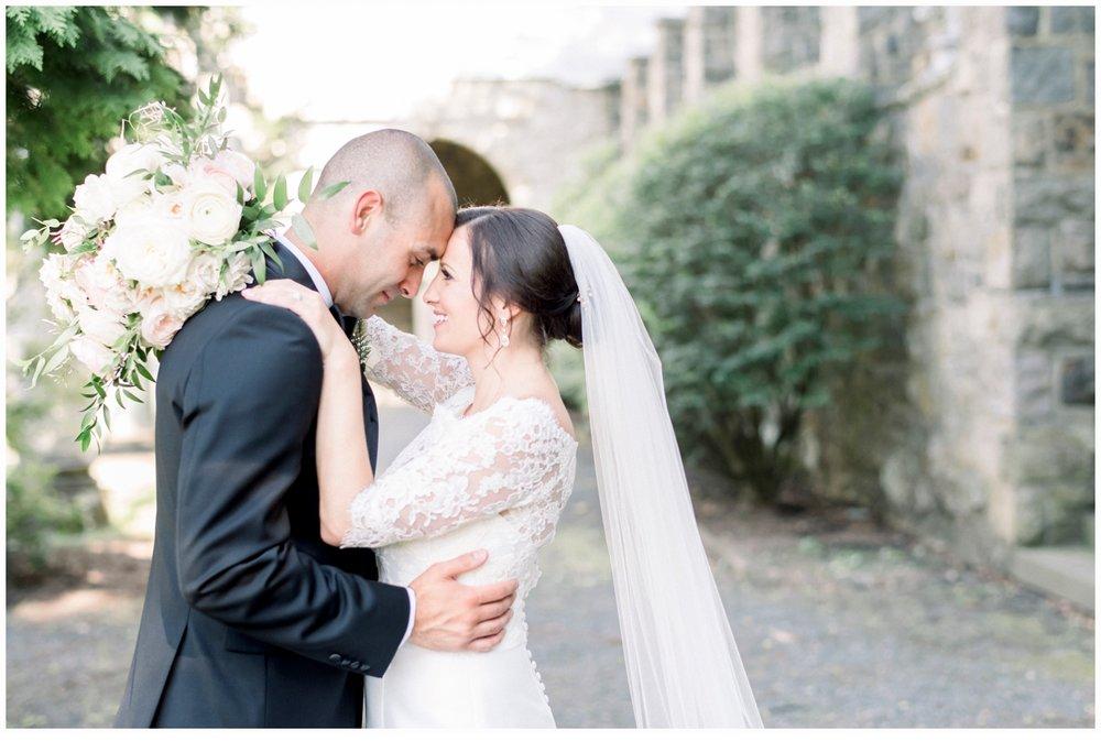 bride and broom hugging