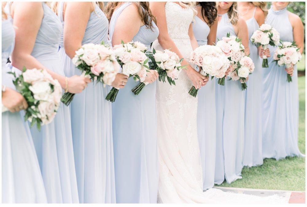 bridesmaids holding floral bouquets
