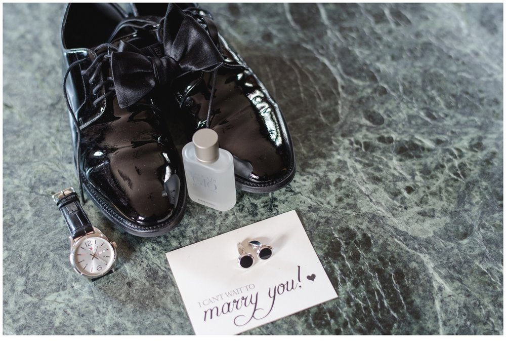 groom's wedding shoes and bow tie