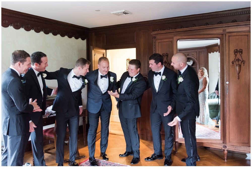 groom and groomsmen on wedding day laughing