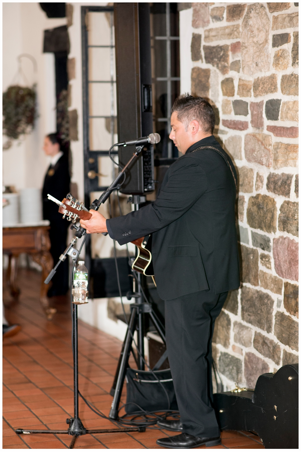 guitarist playing at cocktail hour on wedding day