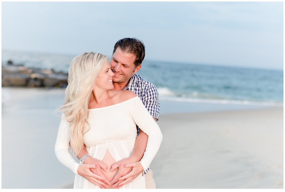husband and wife hugging on beach