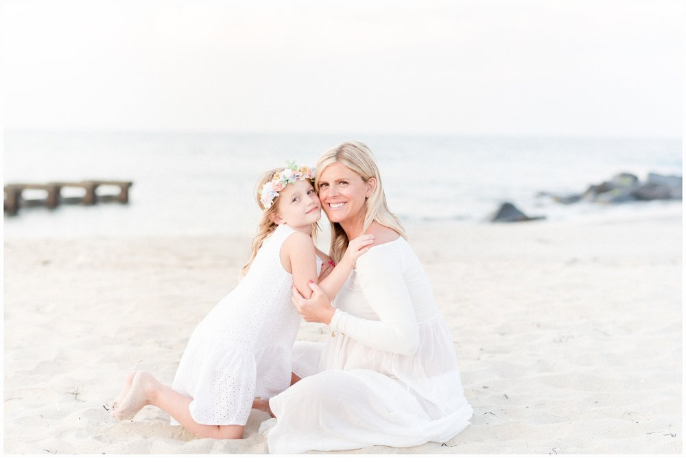 expectant mom with child on beach