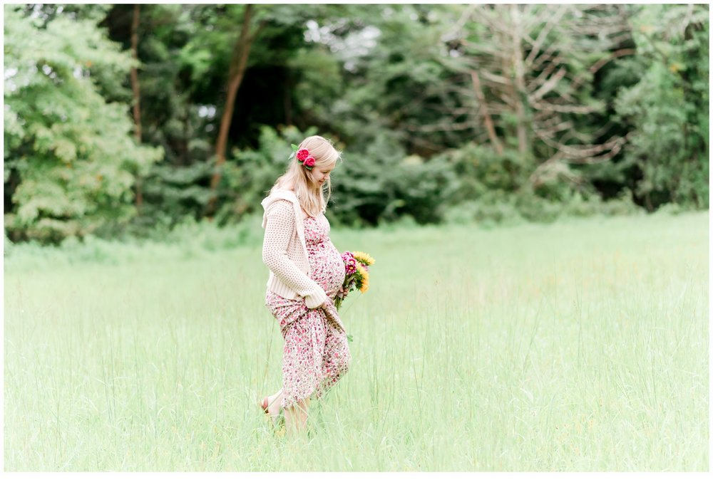 pregnant woman walking in field