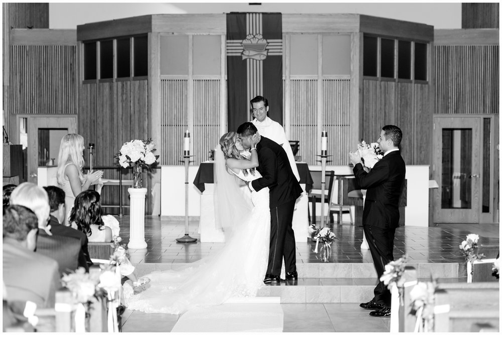 bride and groom kissing at church