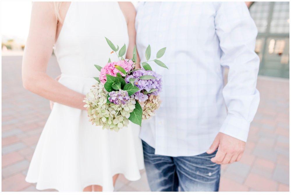 engaged couple holding flowers