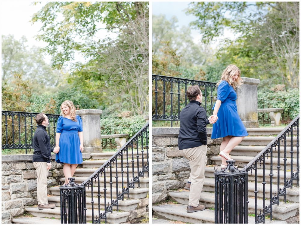 a couple on an engagement session walking up stairs