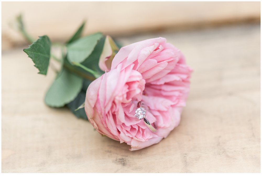 pretty engagement ring in a pink flower