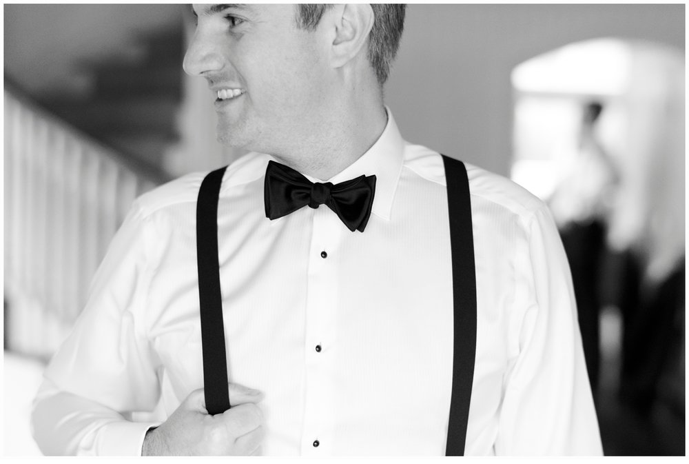 groom wearing a black tux