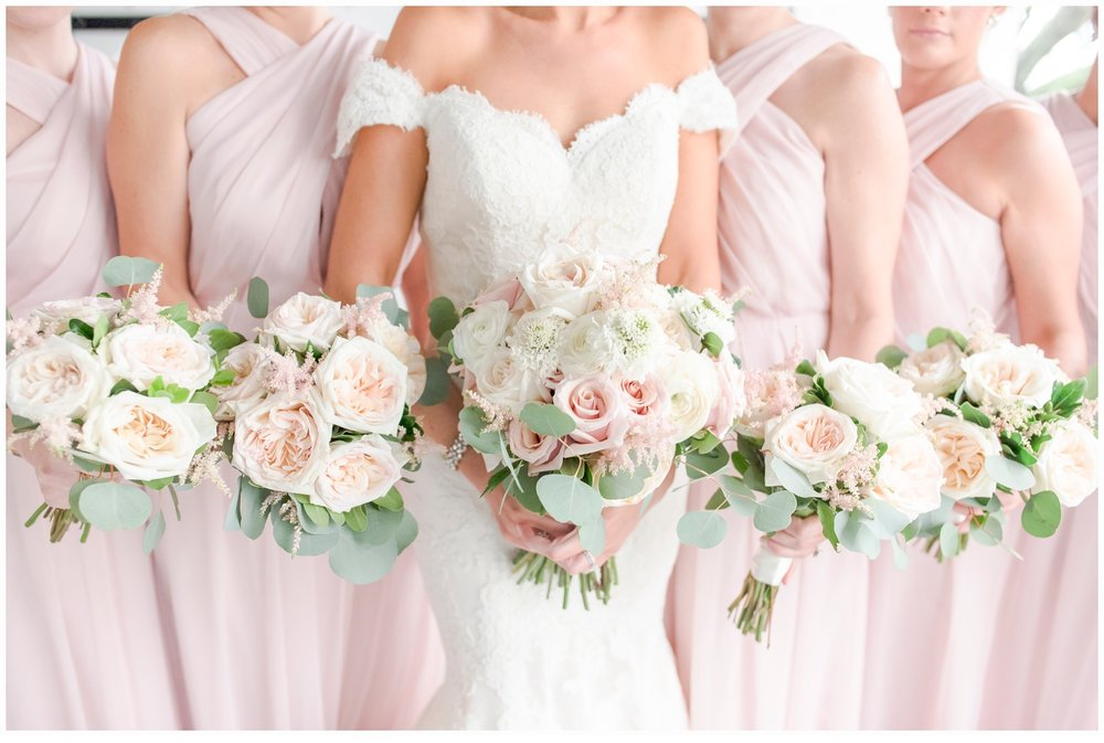 bridesmaids holding wedding bouquets