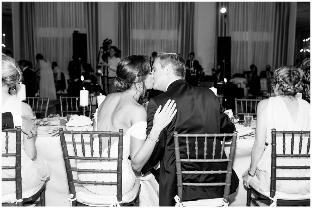 bride and groom kissing at spring lake bath and tennis club spring lake nj