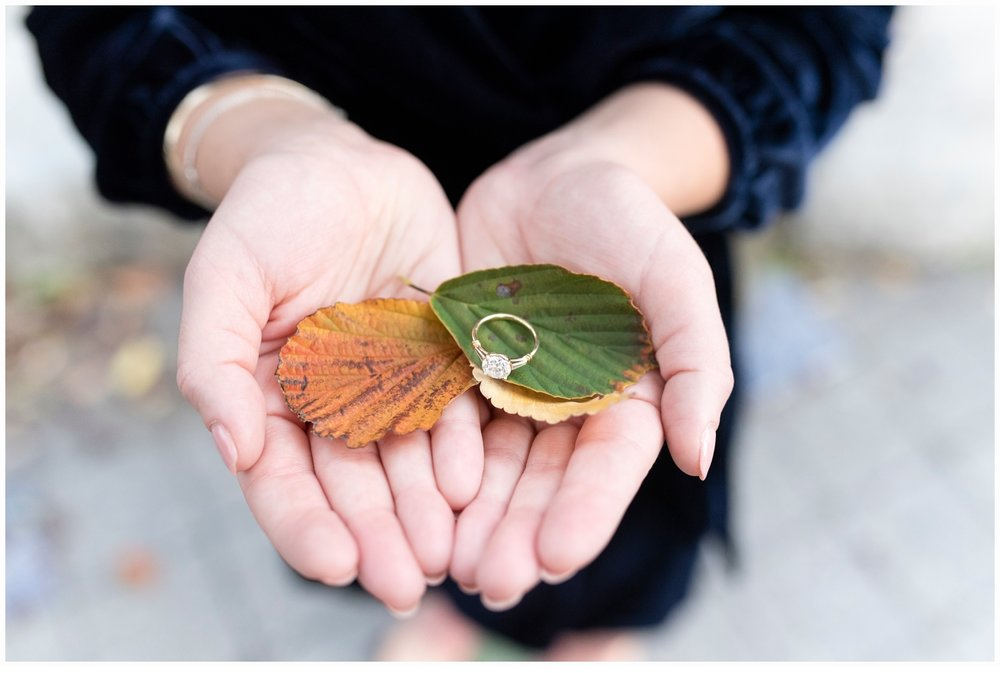 pretty ring shot in hands with leaves