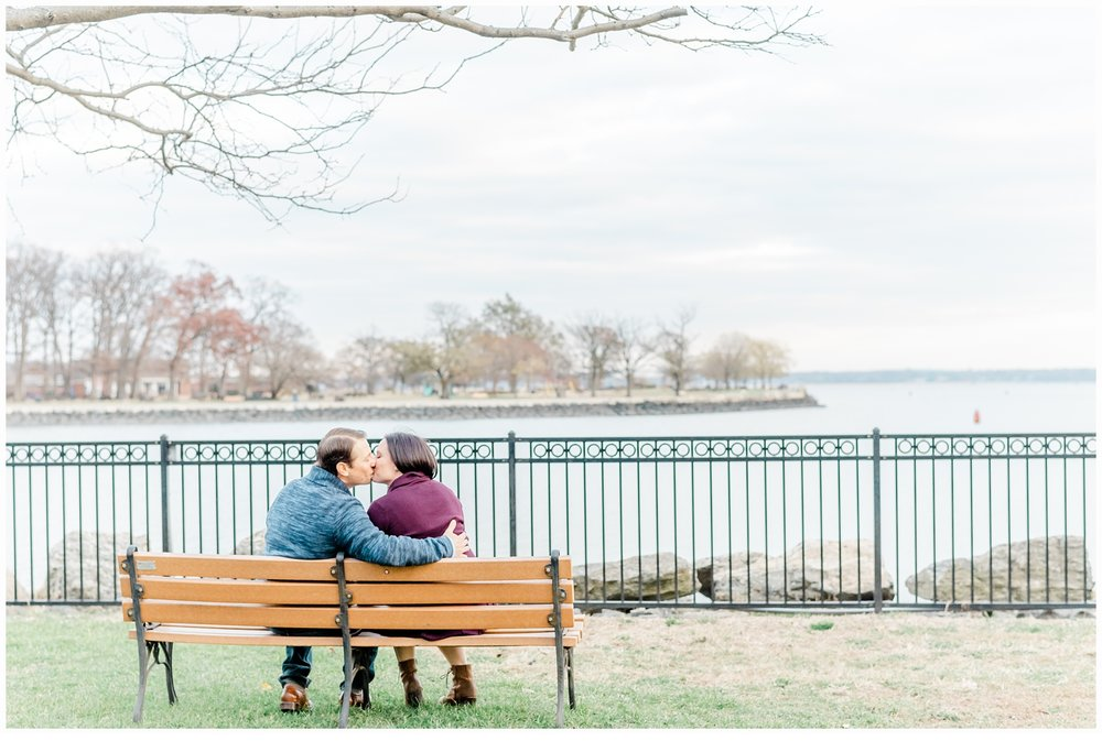 engaged couple sitting on a park bench