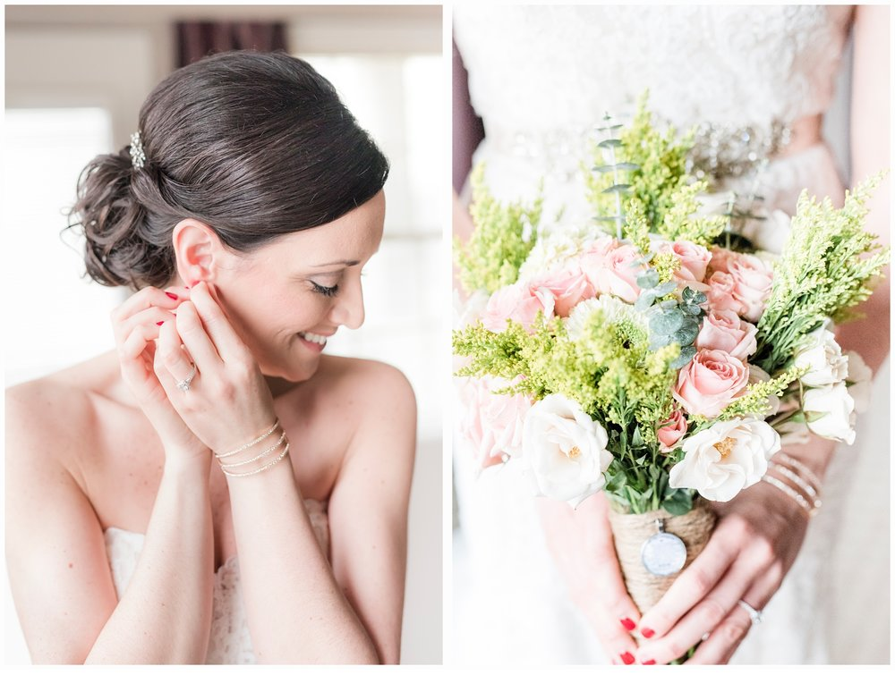 bride putting on earrings on wedding day