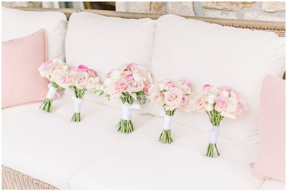 pink wedding bouquets on sofa
