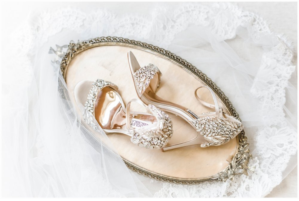 bridal shoes on gold tray