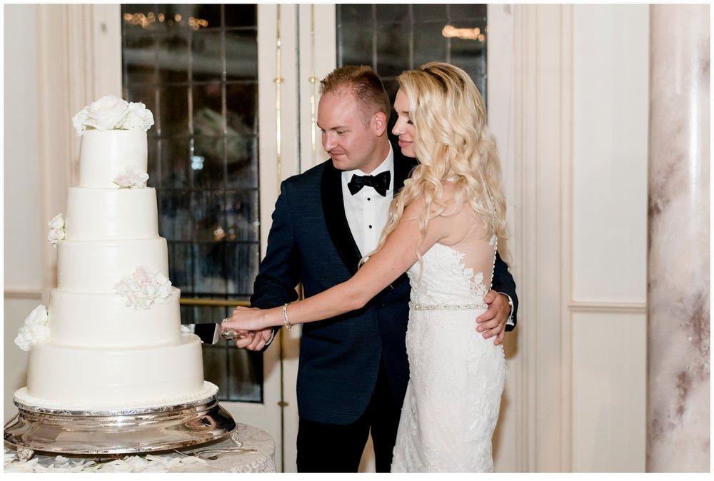 bride and groom cutting wedding cake
