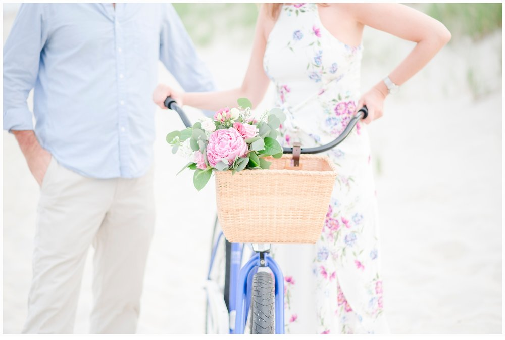 engaged couple riding a bicycle