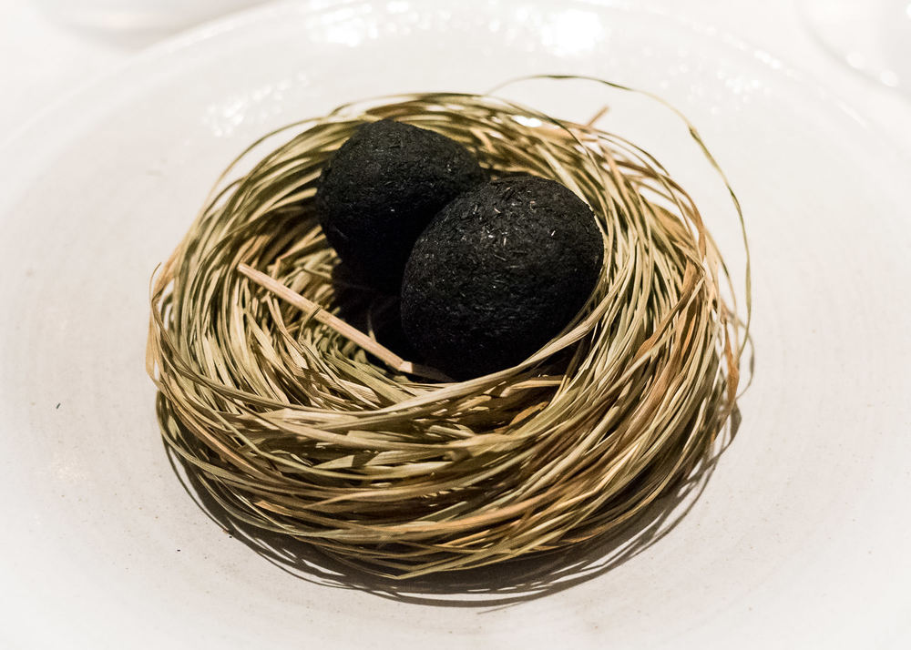 A small egg coated in ash, sauce made from dried trout and pickled marigold (v)