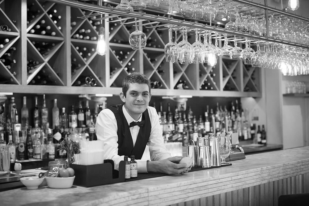 "Merlin Griffiths    ""I had an ostentatious way of cutting my pours back then that ended up with a bottle flying across the bar straight into the side of a chaps head!"""