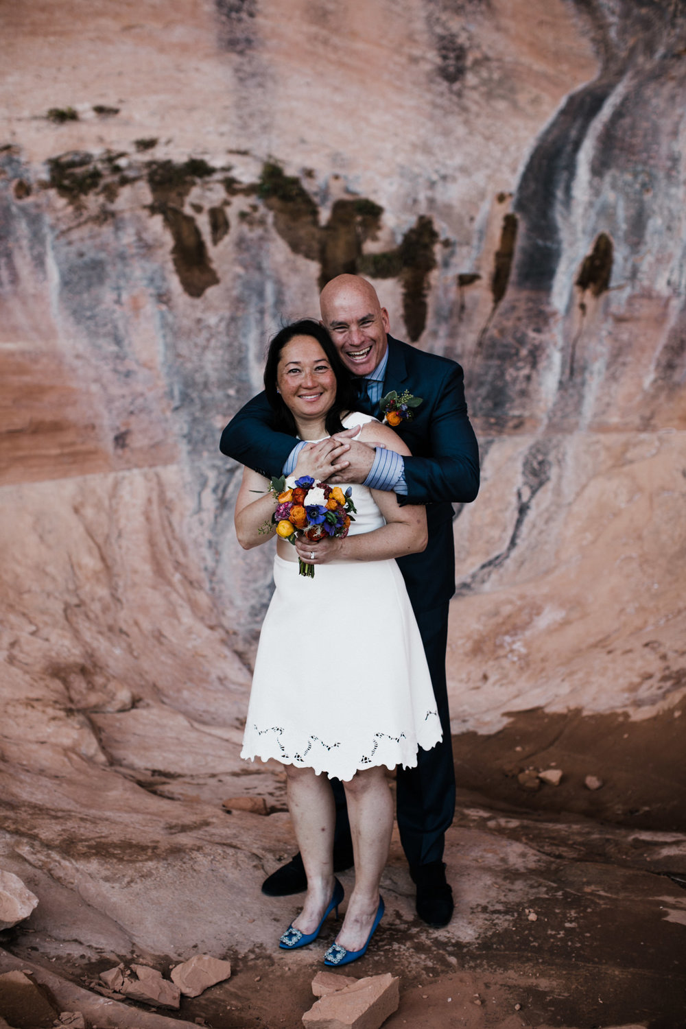 bob + janice's adventurous hike-in elopement | desert arch wedding inspiration | moab, utah intimate wedding photographer | the hearnes adventure photography | www.thehearnes.com