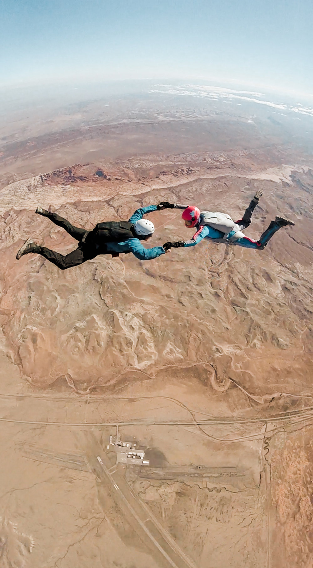wedding photographers enjoying an off day skydiving over arches national park and canyonlands national park in moab