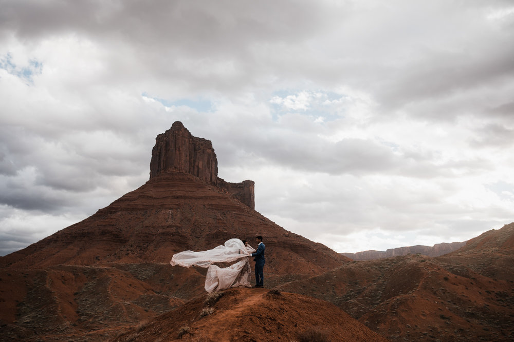 windy adventure elopement in moab, utah