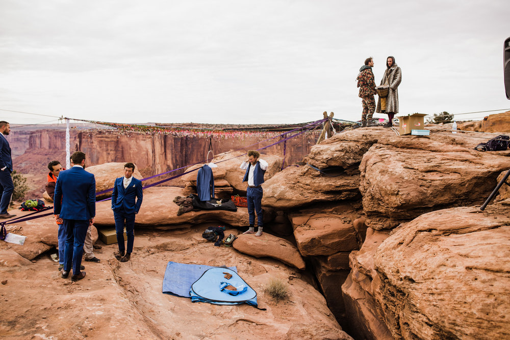 spacenet wedding 400 feet above a canyon in moab, utah | adventurous desert elopement | galia lahav bride | the hearnes adventure wedding photography | www.thehearnes.com