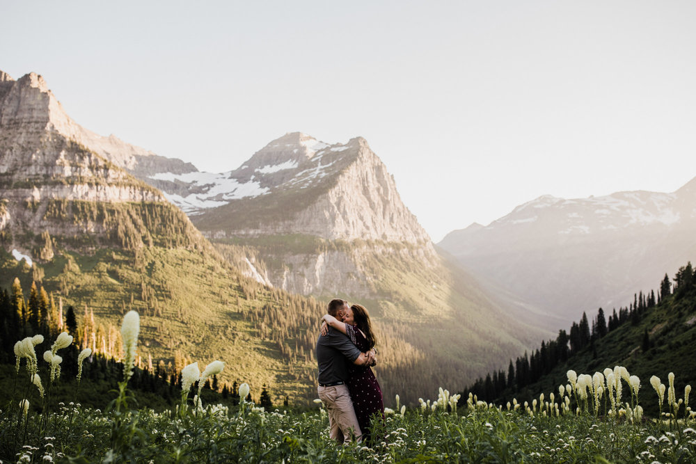 mountaintop engagement session in glacier national park | destination engagement photo inspiration | utah adventure elopement photographers | the hearnes adventure photography | www.thehearnes.com